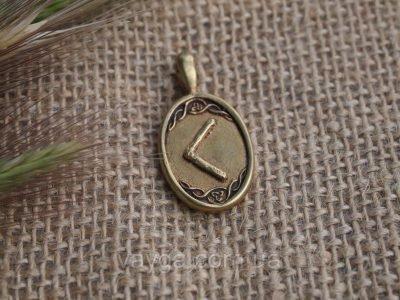 Медальон с руной Кеназ