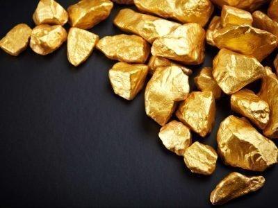 Самородки золота на ткани